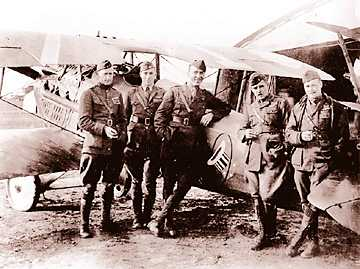 "Eddie Rickenbacker, center, with other members of the 94th Aero (""Hat in the ring"") Squadron. The squadron was based at Selfridge."