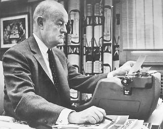 John S. Knight at typewriter