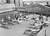 Women staffers on rooftop deck
