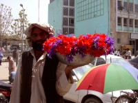 Naw Roz flower seller in front of MoIC (photo by Linda Mazur)